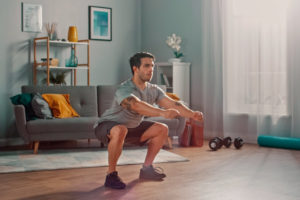 Man practicing physical therapy at home